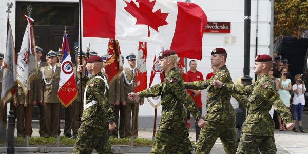 A military unit from Canada marches during a military parade marking Polish Armed Forces Day, in Warsaw, Poland, Friday, Aug. 15, 2014. Poland is holding its biggest military parade in years with tanks and soldiers moving through central Warsaw and military aircraft flying overhead. The parade comes on the August 15 holiday that honors a stunning Polish victory against Russian Bolsheviks in 1920. A group of Canadian soldiers are taking part in military exercises in Poland.(AP Photo/Czarek Sokolowski)
