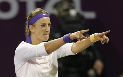 Azarenka of Belarus celebrates after defeating Williams of the U.S. in the final of the Qatar Open tennis tournament in Doha